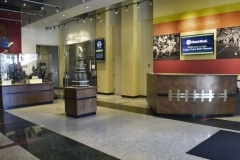Display case and reception desk with football facade